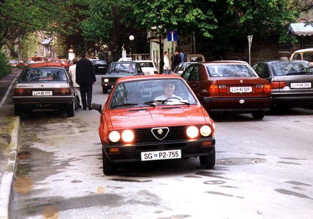 Perhaps first foto of the Red bird. Early November of 1994, Ljubljana, in front of Medical faculty. Me behind the wheel. Note old look of my Alfa with black bumpers.