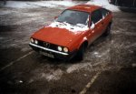 Snow on car, winter 1994: my Alfa had supreme snow condition driving abilites. Luckily, snow will never again fall on her.